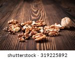 walnuts on wooden table | Shutterstock . vector #319225892