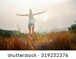 young woman meets sunrise in... | Shutterstock . vector #319252376