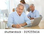 portrait of senior man working... | Shutterstock . vector #319255616