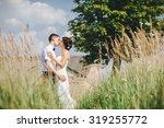 beautiful bride and groom... | Shutterstock . vector #319255772