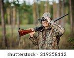 man hunter with shotgun looking ... | Shutterstock . vector #319258112