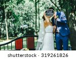 """bride and groom holding """"just... 
