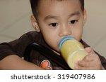 cute little boy with bottle of ...   Shutterstock . vector #319407986