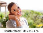 happy young woman standing... | Shutterstock . vector #319413176