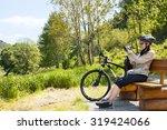 woman cyclist traveler sitting... | Shutterstock . vector #319424066