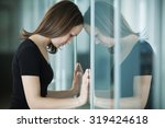 young woman  woman leaned... | Shutterstock . vector #319424618