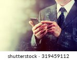 close up of a man using mobile... | Shutterstock . vector #319459112