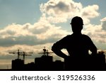 dark silhouette of a builder on ... | Shutterstock . vector #319526336