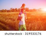 family in the field at the ... | Shutterstock . vector #319533176