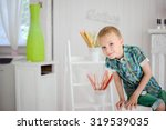 portrait of happy blond boy... | Shutterstock . vector #319539035
