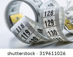 curved measuring tape of the... | Shutterstock . vector #319611026
