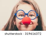 Little Girl With Red Nose....