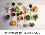 portion cups and spoons of... | Shutterstock . vector #319637378