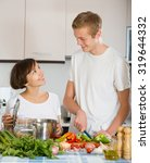 young family couple cooking... | Shutterstock . vector #319644332