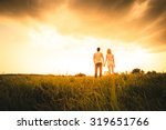 Silhouette Of A Two Persons On...