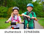 two cute children cycling in... | Shutterstock . vector #319683686
