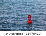 red buoy floating in sea water | Shutterstock . vector #31975420