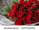 Bouquet Of Red Roses In Wicker...