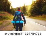 male back packer walking down... | Shutterstock . vector #319784798