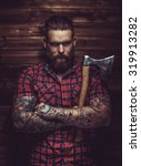 brutal man with beard and... | Shutterstock . vector #319913282