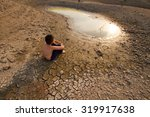 water crisis  child sit on... | Shutterstock . vector #319917638