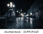 old european city at rainy night | Shutterstock . vector #319919165