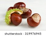 Chestnut On A White  Wooden...
