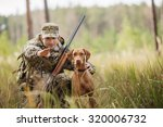 young hunter with a dog on the... | Shutterstock . vector #320006732
