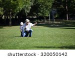 little boy with his grandfather ... | Shutterstock . vector #320050142