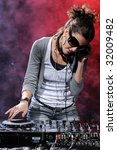 attractive female dj mixing at... | Shutterstock . vector #32009482