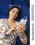 caucasian woman passenger in... | Shutterstock . vector #320139212