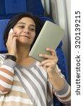 caucasian woman passenger in... | Shutterstock . vector #320139215