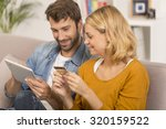 young couple buying on internet | Shutterstock . vector #320159522