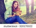 redhead girl autumn leaves | Shutterstock . vector #320170322