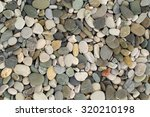 texture of pebbles from a beach ... | Shutterstock . vector #320210198