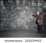genius aged teacher explains a... | Shutterstock . vector #320229452