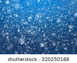 falling snow on the blue... | Shutterstock . vector #320250188