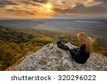 sunset from the top. a woman on ... | Shutterstock . vector #320296022