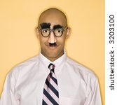 Small photo of African American man wearing groucho mask disguise.