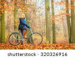 happy active woman riding bike... | Shutterstock . vector #320326916
