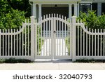 White Wooden Gate And Picket...