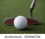 golf putter set up to the ball | Shutterstock . vector #320466746