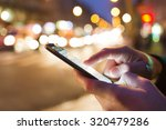 man using his mobile phone in... | Shutterstock . vector #320479286