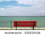 Small Red Bench Overlooking Th...