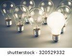 White Light Bulb Glowing Among...