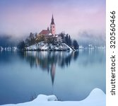 rainy of day at the lake bled... | Shutterstock . vector #320560466