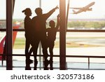 silhouette of young family at... | Shutterstock . vector #320573186