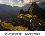 Machu Picchu Illuminated By Th...