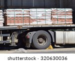 truck loaded with paving stones ... | Shutterstock . vector #320630036