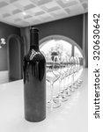 Black Wine Bottle On The Table...